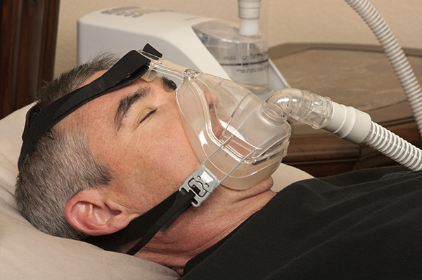 Man wearing CPAP machine