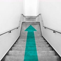 stairs with a downward facing arrow